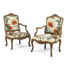Two carved walnut armchairs,Early Louis XV, second quarter 18th century.
