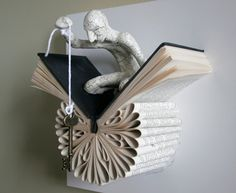 Daniel Lai - books and small characters interacting with these books