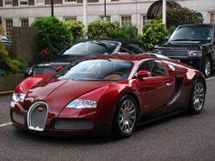 Deep Red Bugatti... Hard to believe a Bentley and Range Rover could ever be overshadowed!