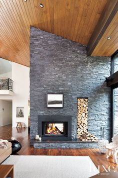 stone fireplace - Design Insight from the Editors of Luxe Interiors + Design Modern Stone Fireplace, Stone Fireplace Designs, Brick Fireplace, Living Room With Fireplace, Fireplace Surrounds, Fireplace Ideas, Airstone Fireplace, Stone Fireplaces, Living Rooms