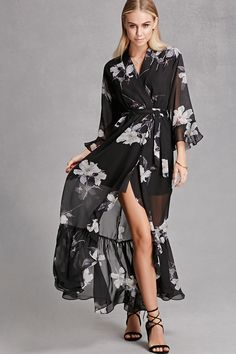 A semi-sheer woven maxi dress by Selfie Leslie™ featuring an allover floral print, a surplice neckline, 3/4 trumpet sleeves, an elasticized waist, a removable self-tie sash, side belt loops, and a split high-low tulip style front with a ruffled hem.