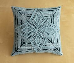 "This a 12"" pillow with two crocheted squares stitched together over it. The pattern utilized is one of my own. The thread is 100% mercerized cotton over 100% cotton fabric stuffed with polyfill. Ready to Ship. Crystal Blue thread over charcoal grey colored fabric. ***Be warned, I own cats and fuzz here or there is unavoidable. I do all I can to minimize the amount but as anyone who owns a cat/dog can tell you you're fighting a loosing battle.*** I am always open to custom pro..."