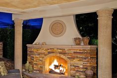 Stunning outdoor fireplace with covered seating. Stunning outdoor kitchen with color changing lights beneath the bar.  From 1 of 8 projects by AAA Landscape Specialists, discovered on search.porch.com #outdoorliving