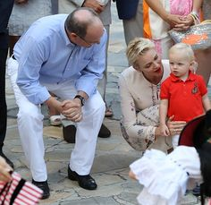 Prince Albert II of Monaco and his wife Charlene of Monaco attend a dance show with Prince Jacques, the heir apparent to the Monegasque throne during the traditional Monaco's picnic, on September 10, 2015 at Monaco.