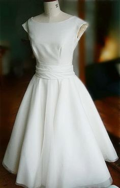 1950s wedding dress (for the bridesmaids) I had this dress for my bridesmaids in navy blue 16 years ago . LOVE !