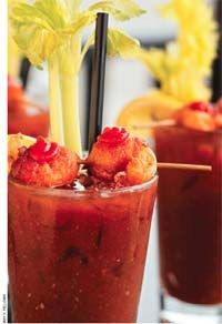 ... Sriracha on each and a stick of celery at the top of the glass. The