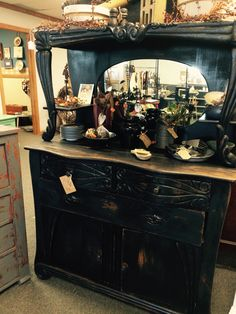 """This is a fabulous antique oak buffet that has been updated with a custom black distressed finish. $325 from dealer TOC. 62""""tall x 46"""" We are packed full of fantastic furniture, vintage finds, home decor and gifts, many one of a kind created or recreated by our talented vendors. An eclectic mix of old and new treasures. Come explore for yourself! Open everyday 9-6!  I-29 and Highway 71, St. Joseph, MO"""