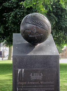 In front of the Dial Arch pub, Woolwich. A memorial to the football club which began as Dial Square FC, before becoming Royal Arsenal, Woolwich Arsenal and then just plain Arsenal, after they had left Woolwich for Islington.