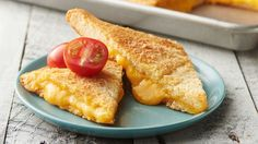 Sheet-Pan Crescent Grilled Cheese - Grilled cheese for a crowd! Crescent dough brushed with seasoned butter and stuffed with gooey cheese. It's great for serving as a main meal or cut into smaller portions for appetizers. This flavorful dish will not disa Crescent Dough, Crescent Rolls, Crescent Ring, Sauerkraut, Brie, Pizza Hamburger, Hamburger Casserole, Chicken Casserole, Cheddar