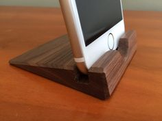 This stylish iPhone 6 stand is handmade using walnut hardwood and finished with three coats of a durable oil/varnish blend followed by paste wax—all applied by hand and the same finish I use for high-end furniture. The finish will withstand heavy use even in the kitchen. The stand is cut to precise dimensions to securely hold an iPhone 6 without a case. If you are interested in a stand or dock that can accommodate a phone in a case, take a look at my other products…