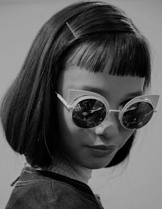 These sunglasses are pretty awesome. Not sure if i could pull off bangs like this but I think it suits this model perfectly