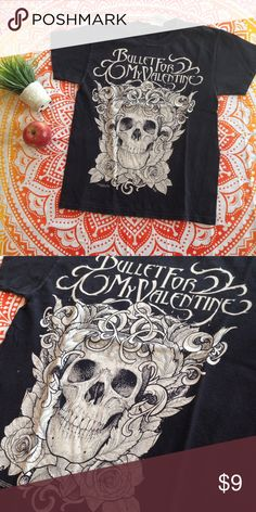 Bullet for my Valentine tee Bullet for my Valentine tee with skull and roses. It has been worn but is still in good shape. It's not a screen print so the imagery is as clear as the day I got it. Size is youth large, but will fit a women's small or men's extra small. Hanes heavyweight tee. Hanes Shirts & Tops Tees - Short Sleeve