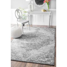 This area rug is crafted with easy to clean microfiber yarns that prevent shedding, unlike wool. The rug features a beautiful vintage medallion pattern that is sure to add elegance to any room. Pile H