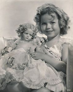 Vintage photo of Shirley Temple with doll.