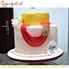 White and Yellow Traditional 2 Tier Nigerian Wedding Cake with Modern style lace and coral bead necklace for Nigerian brides made by Cakes of LA (Laide). Located in Abuja Nigeria. Instagram - cakes_by_la