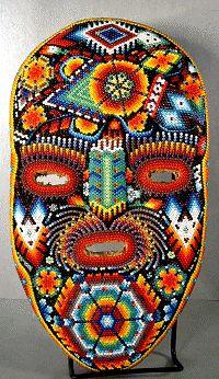 Esta es una  Huichol máscara. Se trata de un arte de México. Que está hecho de perlas. Es difícil de hacer.