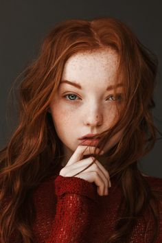 With freckles and fair skin.