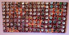 Fabric covered magnetic board with IKEA magnetic tins for organizing beads/rhinestones, etc.