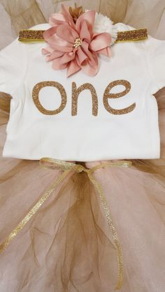 """One year old birthday pink and gold onesie, tutu, and headband.  Cute store: """"The Green Eyed Bride"""" on Etsy.  www.thegreeneyedbride.etsy.com"""