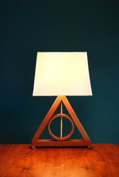 Harry Potter Deathly Hallows Table Lamp Harry Potter Kids Lamp Living Room Lamp Geometric Lamp Master of Death -- I love this because it's not overly obvious. It's beautiful and something only other Potter fans would recognize. Cadeau Harry Potter, Décoration Harry Potter, Harry Potter Thema, Harry Potter Nursery, Harry Potter Deathly Hallows, Harry Potter Gadget, Luminaria Harry Potter, Harry Potter Enfants, Hogwarts