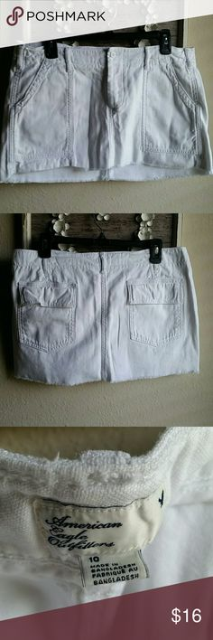 American Eagle white mini Excellent condition.  Never worn only washed. White with light distressing.  Two front pockets and flap back pockets. Waist measures approximately 17 and length is 11 inches American Eagle Outfitters Skirts Mini