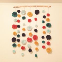 Making these tonight!! Yarn pompom garland, suspended from a stick. Super easy DIY instructions!