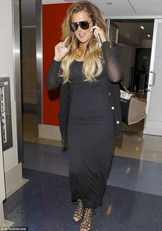 A bit too much? Khloe Kardashian looked quite bronzed as she arrived home to Los Angeles at LAX on Friday