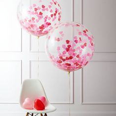 Giant Heart Confetti Filled Balloon. Useful tip - partially fill the balloon with air to create static in the balloon to make the confetti stick to the sides! The pyramid weight will only secure the balloon if it is partially filled with air. #ConfettiBalloon #ValentinesDay