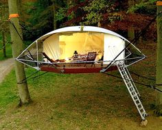 Suspended Dom'Up tree tents look like flying saucers in the forest