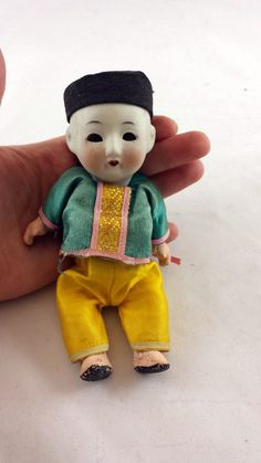 Check out this item in my Etsy shop https://www.etsy.com/listing/257136695/vintage-composition-doll-chinese-doll