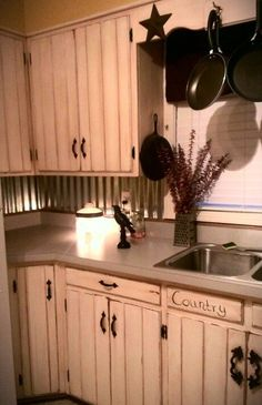 Rustic kitchen -tin backsplash