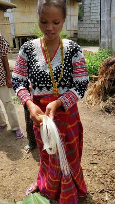 This blouse called Albong Takmon is the signature embroidery of Fu Yabing . She is excellent in this embroidery skill too with the applique (red bands of cloth). Photo by DOT 12 B'laan textile