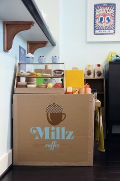 Making a Cardboard Coffee Shop. Creative! Could make a cardboard fruit bar or bakery shop. Endless possibilities! Love the towel bar and the display shelf for the food. Complete it with a cash register(not made out of cardboard).