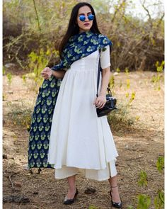 beautiful contrasts with the breezy white. The set includes a flowy kurta with a gorgeous ghera, a comfy short palazzo and a hand block printed dupatta. Match it with a pair of kolhapuris and you are ready with the perfect look this summer! Salwar Designs, Kurta Designs Women, Kurti Designs Party Wear, Kurti Designs Pakistani, Blouse Designs, Indian Attire, Indian Ethnic Wear, Ethnic Outfits, Indian Outfits