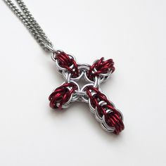 Chainmaille cross pendant in red.