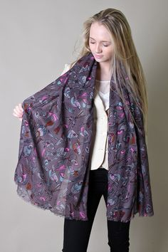 Multi colored jazzy bird print is a great way to make any outfit have an edge of fun to it. Oversized scarf and its perfect to be used as a wrap to