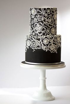 """Brides: Two-Tier Black Wedding Cake with White Lace Pattern. This bold confection by Amy Beck Cake Design proves that a black cake can be beautiful. The lace pattern was created using """"brush embroidery""""— a technique where a paintbrush is stroked through r Black And White Wedding Cake, Black Wedding Cakes, Cool Wedding Cakes, Wedding Cake Designs, Lace Wedding, Trendy Wedding, Wedding Rings, Fondant Lace, Fondant Wedding Cakes"""
