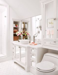 Small bathrooms have the potential to pack in plenty of style within a limited footprint. By employing design elements and storage solutions in strategic ways, you can create an attractive small bathroom with a big impact. Use these small-bathroom decorating ideas to add polish and function in a tight space. #smallbathroom #bathroomdecor #bathroomideas #apartmentbathrooms #bhg Decor, White Bathroom Designs, Interior, Small Bathroom Colors, All White Bathroom, Home Decor, Bathroom Design, Bathroom Decor, Bathroom Color