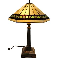@Overstock - This elegant 'Geo' Tiffany style table lamp is made with more than 125 hand-cut pieces of glass soldered into a beautiful shade. This piece is handcrafted using the same techniques that were developed by Louis Comfort Tiffany in the early 1900s.http://www.overstock.com/Home-Garden/GEO-Handcrafted-Stained-Glass-Tiffany-Style-Table-Lamp/7315906/product.html?CID=214117 $118.99