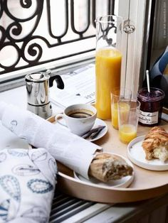 I want to have a slow breakfast like this every morning while watching the activity in the city streets below.