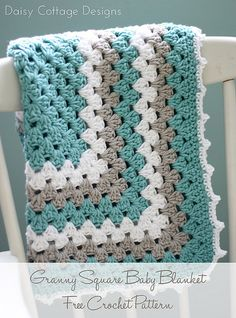 Make this adorable, gender neutral crochet blanket in just a few hours. It's perfect for any upcoming baby shower. It's a modern play on the traditional granny square. #crochetideas #daisycottagedesigns