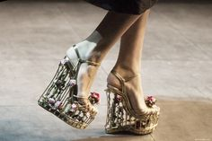 I love the concept of these shoes. They remind of Victorian birdcages or gates.