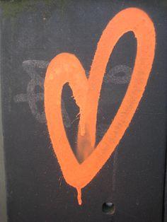 graffiti heart, orange against black background