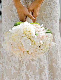 Love the lace and the solid ivory bouquet for the bride.