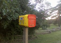 Get wise about waste  {kitty litter bucket repurposed as a mailbox}