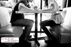 engagement photo shoot at an old fashioned diner