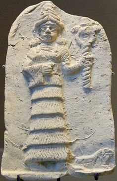 Ishtar holding double serpent wand. Terracotta relief, early 2nd millennium BCE.