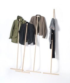 """""""Kleiderstiele,"""" or clothing-sticks, is a boiled-down coat rack—a broomstick to hold garments, designed by Johanna Dehio."""