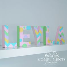 Chevron & Polka Dot Hand Painted Letters for baby Leyla from Compliments  http://complimentsfromsarah.com/2013/02/25/chevron-letters-for-leyla/#