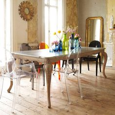 Wood and gold with bright neon bottles. I love those #perspex chairs.